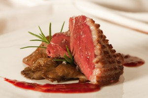Duck breast with raspberry sauce and mushrooms